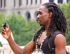 Dreads 1 (LarryJay99 ) Tags: hairy black male men guy smile face hair beads dof arms bokeh masculine manly profile cellphone guys dude backpack facialhair blackman dudes dreads stud studs hairyarms virile canonefs18135mmf3556is ilobsterit