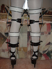 Rear View of Heavy Duty Legs Braces with Heels (KAFOmaker) Tags: leather metal fetish t high shoes highheel braces sandals bondage strap heels cuff brace straps cuffs buckles restraints bracing restraint orthopedics kafo restrained orthopedic strapped buckling braced strapping buckled