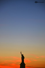Silhouette Of Liberty (Jani Foeldes) Tags: new york city usa sun statue ferry liberty island photography nikon d manhattan nikkor staten 18105 jmk 7000 of