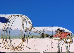 Winding the Rope (not to be confused with Roping the Wind) (Dave van Hulsteyn) Tags: city sign vintage carson cowboy peeling paint neon shadows nevada motel rope nv western lariat frontier