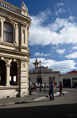 The Gathering (Jocey K) Tags: street autumn newzealand sky people building lamp architecture clouds shadows southisland oamaru southcanterbury tripdownsouth