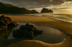 Piha Promontory (zebedee1971) Tags: sunset sea sky sun sunlight beach pool clouds wow rocks waves hills piha warer