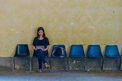 (FriendFisherman) Tags: street red people woman wall reading photo chair nikon df waiting shoot mood sitting foto shot scene sit wait minimalism frau nikkor mensch nikondf