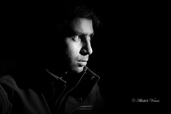 Self Portrait (Explored) (abhishek.verma55) Tags: portrait blackandwhite lights shadow depthoffield strobist flashphotography flash monochrome canon550d yongnuo tamron2470 people experiment bw self selfportrait flickr photography directionallight indoor abhishekverma