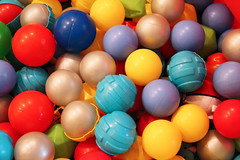 Coloured balls (Katrinitsa) Tags: blue red playing game colors playground yellow kids ball children toy bright balls plastic colored coloured multicolor lots poolballs babytoy ballpool