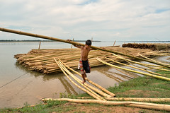 Tmore Kre, Kratie Province - Work for fun? (Mio Cade) Tags: boy work river kid cambodia child bamboo heavy load carry province kenai kratie kre tmore