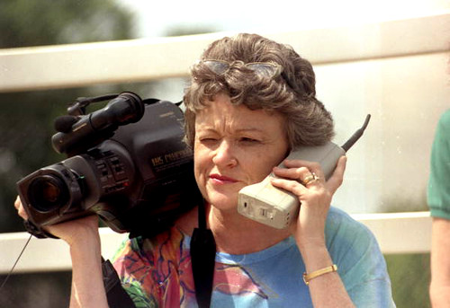 Journalist Lucy Morgan with video camera and phone