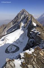 Roopkund as seen from Junargali pass (Bharat Baswani) Tags: mountain lake snow mystery trek skeleton frozen pov pass peak himalaya gali bharat roopkund junar junargali baswani