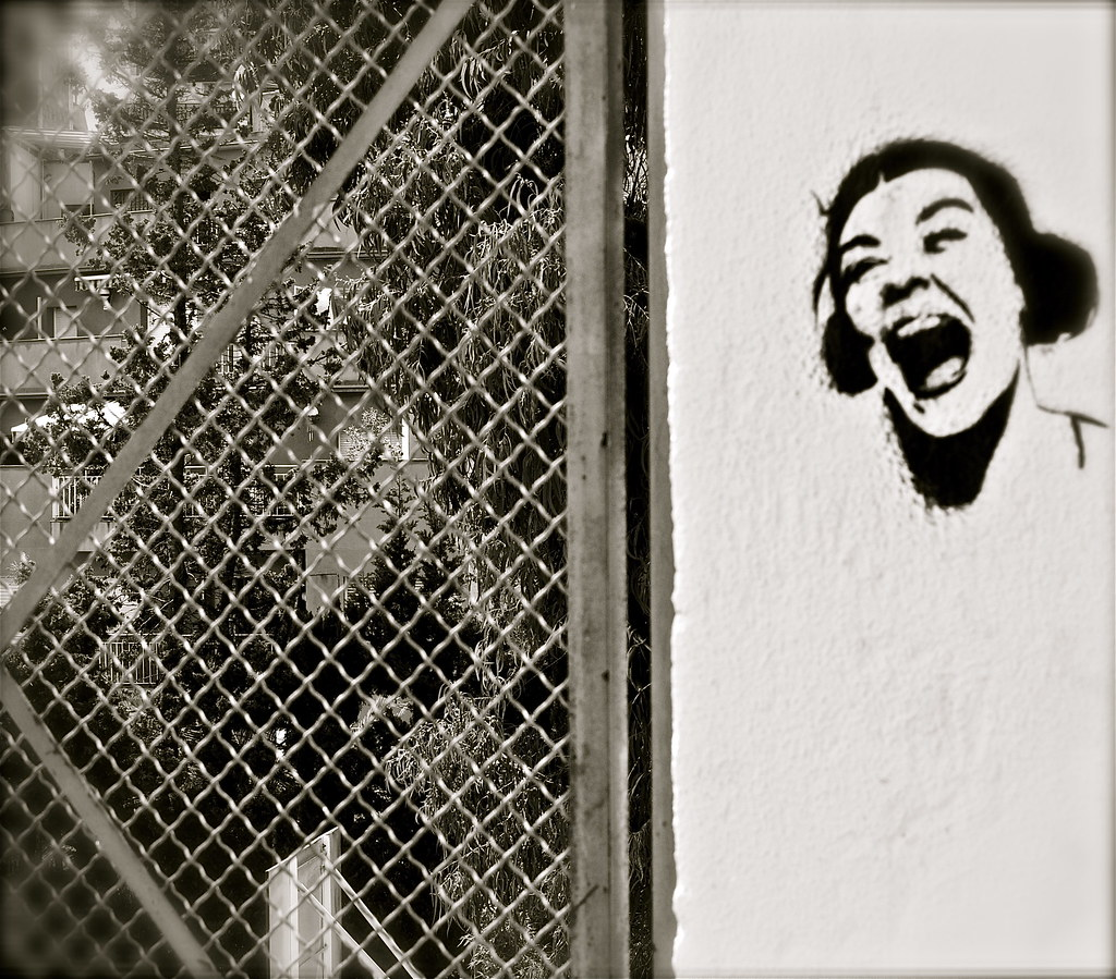 stencil graffiti of a screaming woman