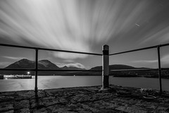 Harbour Nights (Boyd Hunt) Tags: longexposure sea bw mountains skye water night clouds canon dark stars mono dock post jetty barrier cuillins raasay
