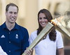 Prince William, Duke of Cambridge and Catherine, Duchess of Cambridge aka Kate Middleton welcome the Olympic Flame to Buckingham Palace during the Olympic Torch Relay London, England