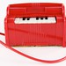 148. Vintage Plastic Wind Piano Toy
