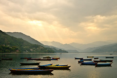 Boats on Phewa Lake [Explored] (clee130) Tags: travel nepal sunset cloud sun lake mountains color water colors clouds lens landscape geotagged boats temple lumix photography boat colorful cloudy panasonic getty 17 pancake 20mm traveling pokhara sunbeam phewa dmc sunbeams gettyimages phewalake f17 m43 npl mft gx1 micro43 microfourthirds panasonicdmcgx1 pashchimanchal lpmajestic geo:lat=2820829329 geo:lon=8395658843