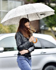 Girl in the Rain (bright.fog) Tags: sanfrancisco street rain umbrella youngwoman leatherjacket capturenx2 nikon135mmf28ais