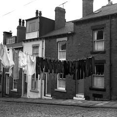 Leeds, UK 1971 (Dizzy Atmosphere) Tags: uk england brick yorkshire cobblestone laundry clothesline rowhouse laundryline leedsuk hanginglaundry rowhousing leedsyorkshire