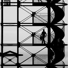 Human in Geometry (Wackelaugen) Tags: people blackandwhite bw white man black tower silhouette canon square person photography eos mono photo blackwhite human googlies wackelaugen