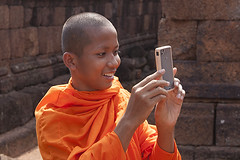 Mobile phone (yuriye) Tags: old boy orange man smile mobile fun religious temple photo student cambodia khmer traditional picture monk angkorwat tourist siem shooting tradition siemreap angkor budda buddism buddist yuriye