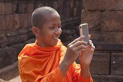 Mobile phone (yuriye) Tags: old boy orange man smile mobile fun religious temple photo student cambodia khmer traditional picture monk angkorwat tourist siem shooting tradition siemreap angkor budda buddism buddist yuriye