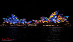 Ships that pass Vividly in the night.. (Kent Johnson) Tags: 1600logodiptychpassing2f0421 vivid sydneyoperahouse water night fujifilmxpro1 xf35mmf14r photoshop diptych colour projections 2016 blue yellow