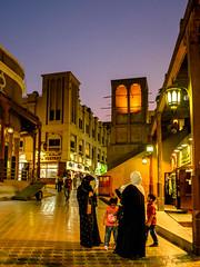 Dubai Old Town, historic Souk, Burj Dubai, Dubai Creek (cityguidelounge) Tags: road outdoor architecture dubaisouk souk night evening people dubainights burdubai dubaicreek seaside market historictown historic