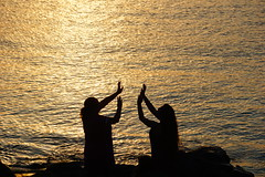Praying for the sun (Hal Skygene) Tags: ocean light sunset shadow sea sun motion reflection beach nature water sunshine silhouette japan asian outside photography asia bright outdoor prayer beam shore shade oriental ethnic seashore shining