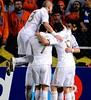 Real Madrids players celebrate after French forward Karim BENZEMA scored his teams first goal against APOEL during their UEFA Champions League first leg quarter-final football match at GSP Stadium in Nicosia on March 27, 2012. AFP PHOTO / PIERRE-PHILIPP