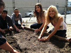 Malin Akerman and students planting tomatoes