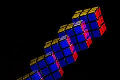 Stroboscopic - Rubik's Cube (philipJvernon (www.philipJvernon.co.uk)) Tags: light england color colour fall bulb club speed high smash unitedkingdom sony leicester spin united flash tube balloon 85mm photographers kingdom drop pop cube 28 burst alpha 450 speedlight f28 explode rubiks highspeed strobe rubik strobist a450