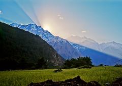 Crepuscular rays at dawn Annapurna Himal, Nepal 1989 (Julian Cooper) Tags: nepal sun mountains sunrise dawn rays himalaya hdr himalayas crepuscular