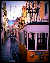 Elevador da Bica - Lisbon, Portugal (Blue Rave) Tags: pictures city people urban building art portugal colors yellow architecture buildings graffiti vanishingpoint europa europe colours angle metro path trolley framed lisboa lisbon transport angles tram diagonal hills lamppost transportation transit frame publictransport streetcar pathway 2012 funicular framedportraits thecoloryellow picturesinaframe