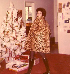 me modeling a genuine CHEETAH COAT AT XMAS (Sugarbarre2) Tags: show christmas ca old city light wild urban orange woman brown holiday hot tree cute art nature fashion animal metal vintage dark hair fur mom toy gold photo cool minolta mini s babe spots mature wife granny cruelty