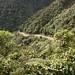 La strada dissestata prosegue stretta verso valle