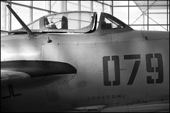 MiG-15bis (Eric Flexyourhead) Tags: seattle bw usa detail museum airplane blackwhite washington fighter aircraft chinese jet cockpit soviet canopy russian fragment kingcounty mig15 mikoyangurevich seattlemuseumofflight mig15bis olympusep1 panaleica25mmf14 leicadgsummilux25mmf14asph