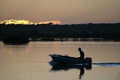 Cigarette (Lexandeer) Tags: sunset sea water canon mirror fishing tramonto mare ship mud d 400 laguna tamron palude sigarette valli marinaromea canon400d tamron70210