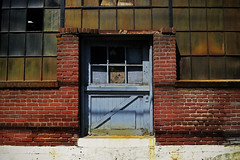 The Blue Door (avilon_music) Tags: door buildings la bricks oldbuildings warehouse rusted bluedoor weatherd