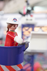 BANGKOK - MAY 6, 2016 : Playmobil lady with spaceship logo on her construction hat working in front of abstract blur background space launch site. Space and astronaut concept. Selective focus on eye. (enchanted.fairy) Tags: