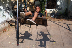 Swinging - Varanasi, India (Maciej Dakowicz) Tags: city people india girl playground children fun action swings varanasi swinging benares