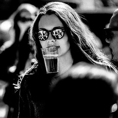 Eating your beer (Hans Dethmers) Tags: blackandwhite woman beer girl monochrome sunglasses flickr fuji zwartwit bier youngwoman vrouw zonnebril hansdethmers