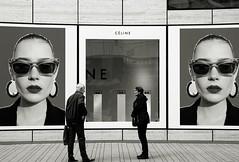 CLINE (Gerd Trynka-Ottosohn) Tags: street bw shop germany advertising poster schaufenster shopwindow werbung dsseldorf cline marriedcouple ehepaar schwarzweis streetphotoraphy bigsisteriswatchingyou gerdtrynka xf56mmf12 ottosohnfoto fujixt10