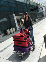Amber Leaving Town, Many Red, One Purple Suitcases and A Wave Goodbye (Lynn Friedman) Tags: sanfrancisco travel home smile airport sfo wave tourist return arrival cart visitor suitcase departure smartcart 94128 lynnfriedman
