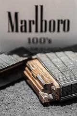 Macro Mondays - Hot/Cold (flat6s) Tags: macro lens 50mm minolta bokeh cigarette depthoffield marlboro lighter stdupont hotcold lensadapter fotodiox macromondays sonya700