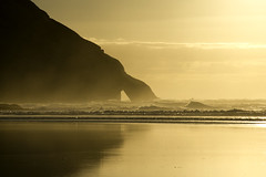 Golden Arch (Tim Bow Photography) Tags: ocean sunset sea newzealand orange storm color colour beach water yellow golden movement waves alone quiet tide stormy nelson nz british welsh tasman tasmansea swell tidal washedup isolated froth svenska wharariki goldenarch landscapephotography whararikibeach timboss81 timbowphotography