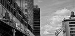 Cruiseship in Amsterdam (Bas Tadema) Tags: camera cruise windows shadow bw reflection amsterdam architecture boot boat cruising olympus terminal passengers ramen cruiseship zwart wit piet handelskade reflectie schip oostelijke shaduw heinkade