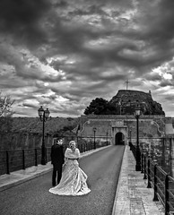 what is marriage (dtsortanidis) Tags: road street wedding bw castle canon photography groom costume hand dress artistic quote mark perspective marriage fisheye greece together ii crop 5d cropped lamps corfu kerkyra hold dimitris dimitrios 815mm tsortanidis