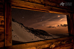 Rocky Mountain Nightscape Picture Window (Mike Berenson - Colorado Captures) Tags: sky moon snow mountains boston night clouds stars snowshoe spring cabin ruins colorado mine alpine sirius orion moonlight allrightsreserved tramstation lightpaint mayflowergulch bostonmine starryskies fletchermountain coloradocaptures copyright2012bymikeberenson nighttimesnowshoetrekabovetimberline