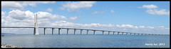 This is the long bridge. However there is the short path to European Champion! - Ponte Vasco da Gama Lisbon X0833e (Harris Hui (in search of light)) Tags: travel bridge vacation canada portugal vancouver clouds europe fuji bc euro lisboa lisbon soccer wideangle panoramic richmond fujifilm ronaldo cloudscape pointshoot cristianoronaldo tagus 2012 parquedasnaes pontevascodagama travelphotography vacationtravel digitalcompact rivertagus euro2012 longestbridgeineurope harrishui vancouverdslrshooter fujix10 motionpanoramic shortpathtoeurochampion czechvsportugal