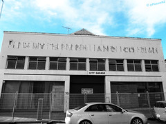 I Cannot Read Ancient Greek (Steve Taylor (Photography)) Tags: city newzealand christchurch blackandwhite bw color colour abandoned greek earthquake garage noparking bluesky canterbury bn sin nz signage quake southisland cbd outline left selective unclear illegible unreadable uninhabitable andco undecipherable