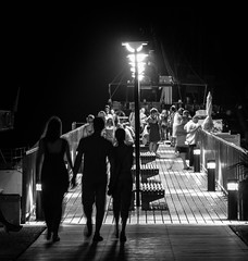 Nightly at the pier (TeryKats) Tags: canon eos cyprus famagusta 500d lefteris paralimni t1i katsouromallis terykats lefteriskatsouromallis nightpier24105eflcanonllensesblackandwhitebw