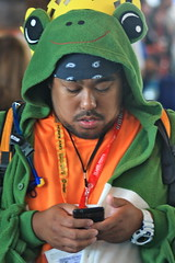 San Diego Comic-Con International 2012: Froggy texting (kevin dooley) Tags: california portrait people man color male guy mobile canon fun book costume comic play phone sandiego sd international convention comiccon comicon 2012 texting frogy 40d coplsya froggt comicon2012