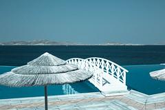 St. John Hotel Pool 2 (NadimC) Tags: bridge blue sea water pool parasol mykonos